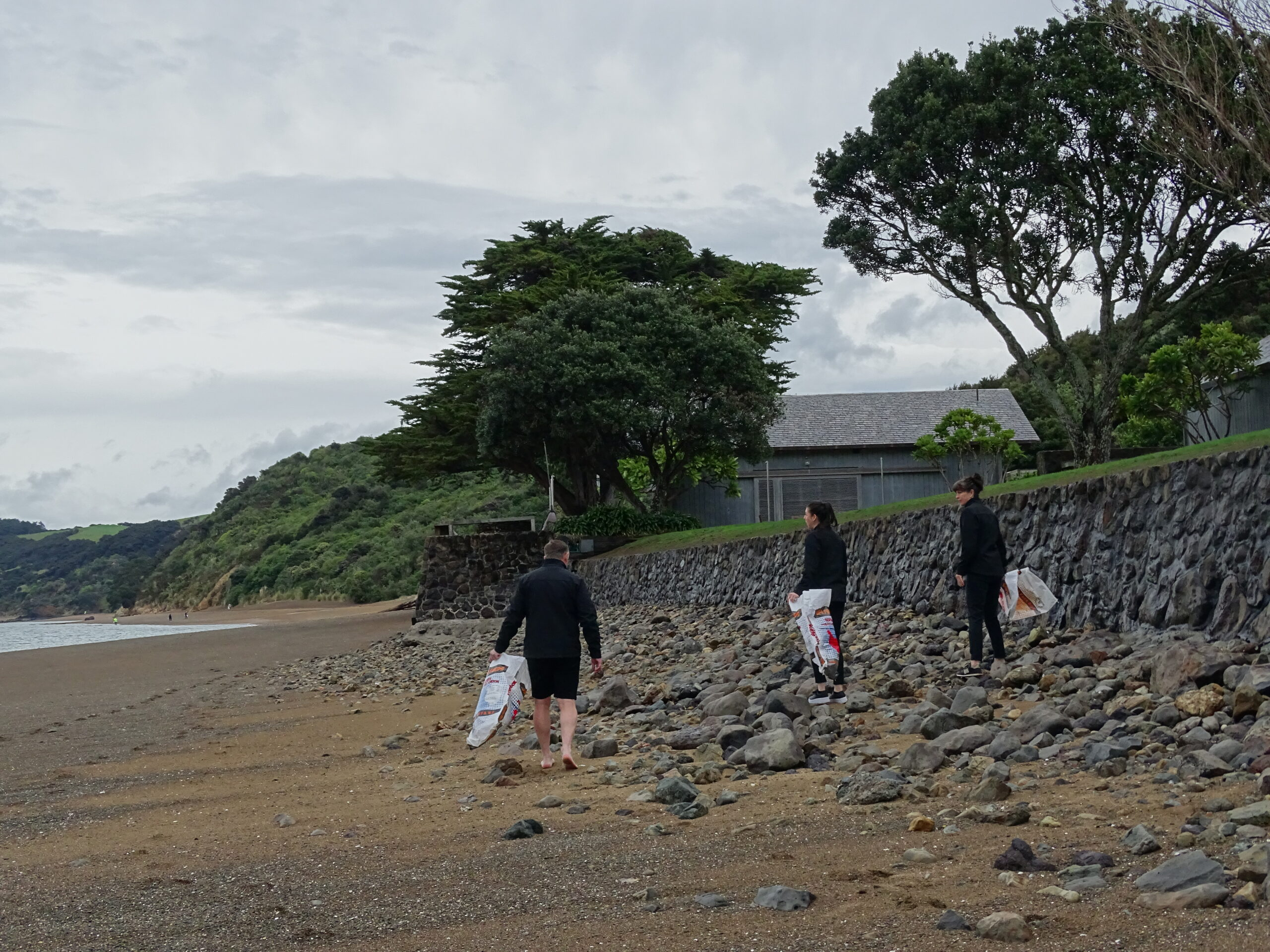 Collecting rubbish from the rock area in front of The Boathouse