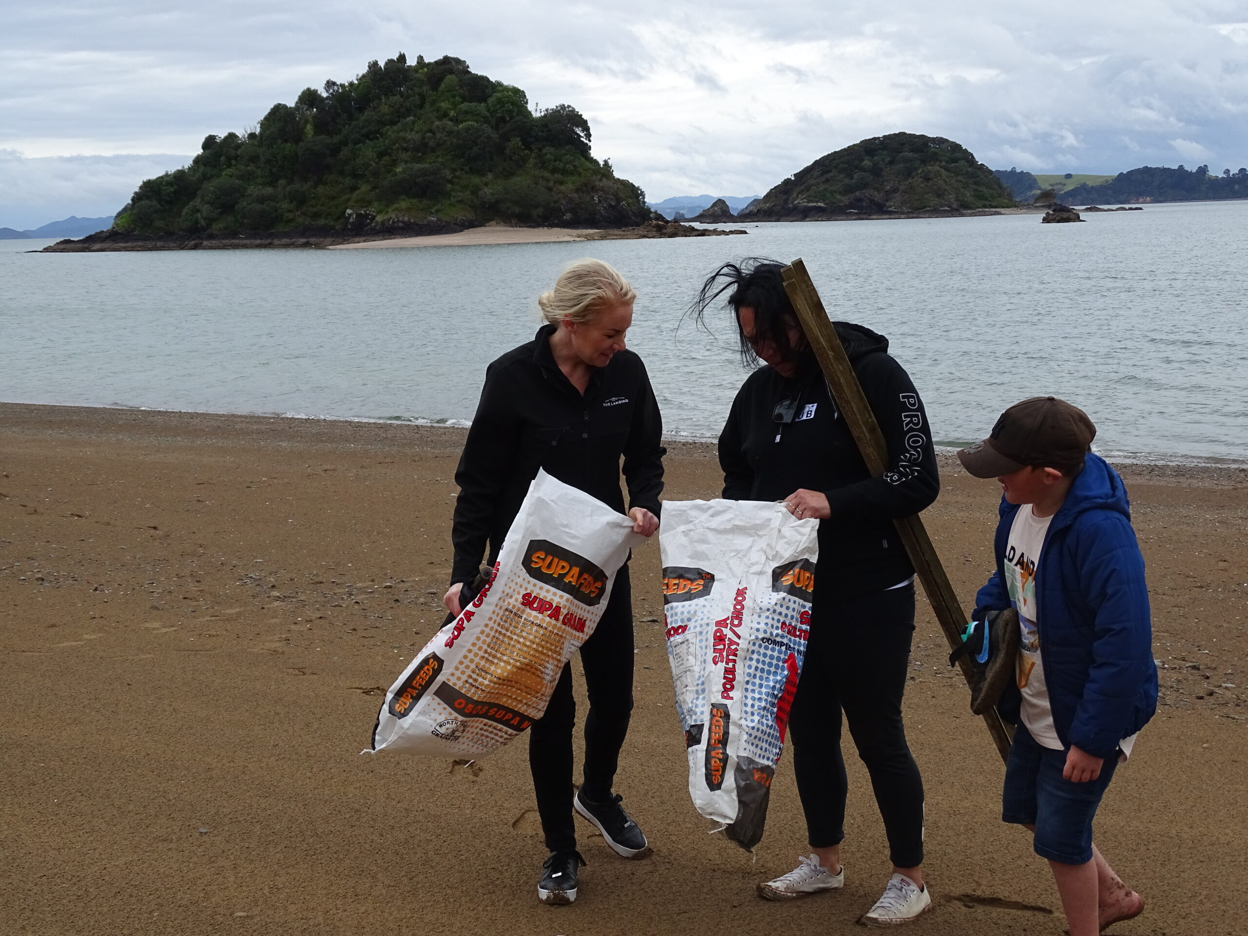 Team members collecting rubbish for the Ocean Clean up