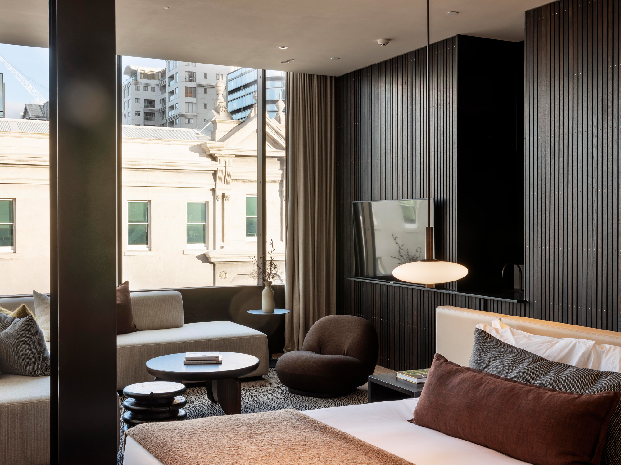 Hohi suite bedroom with window seat facing out to city - The Landing Suites at The Hotel Britomart