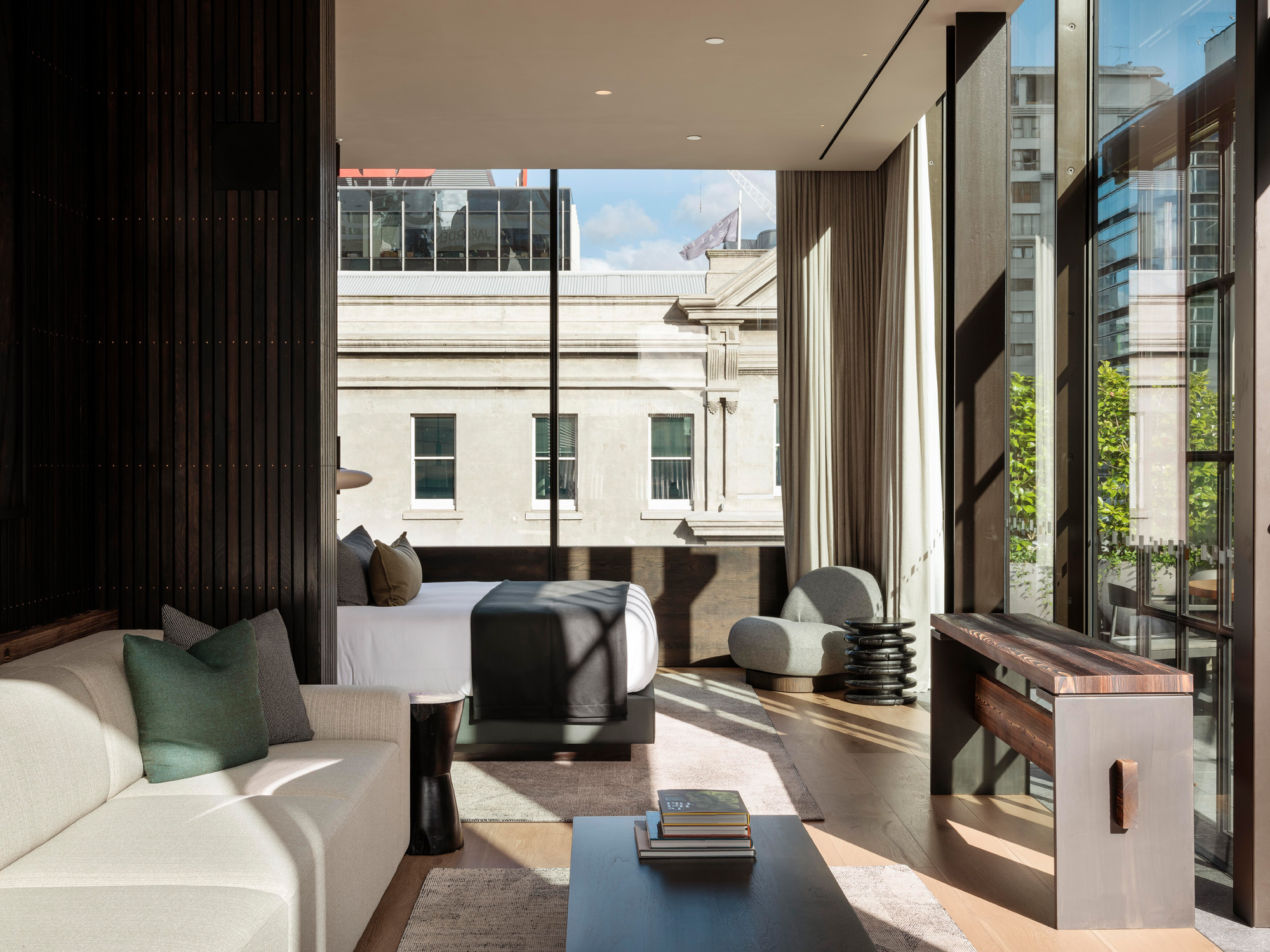 Poraenui suite with bed, lounge and outdoor terrace - The Landing Suites at The Hotel Britomart